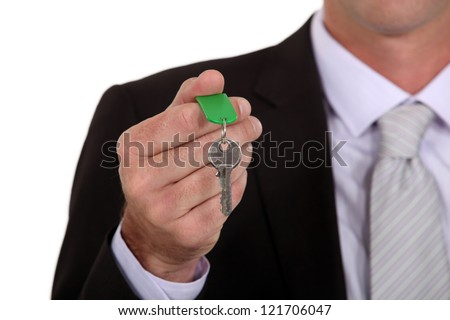 Businessman holding a key - stock photo