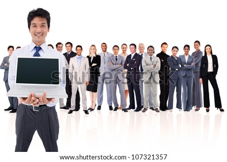 Businessman holding a laptop against a white background - stock photo