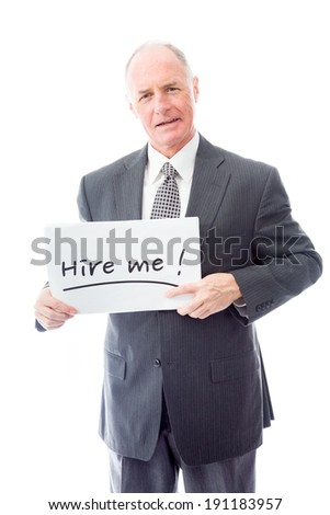 "Businessman holding a message board with the text words ""Hire me"" - stock photo"