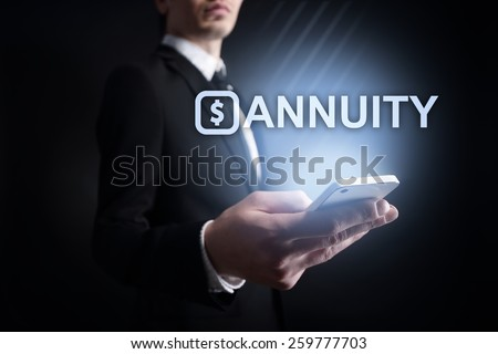 businessman holding a mobile phone with annuity text. Internet concept. business concept.  - stock photo