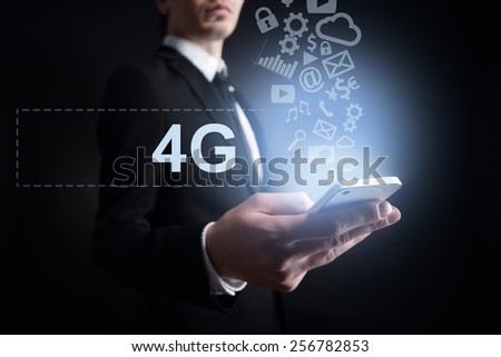 businessman holding a mobile phone with cloud computing text and applications icons. Internet concept. - stock photo