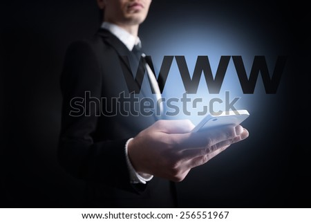 businessman holding a mobile phone with www text. Internet concept. business concept. - stock photo