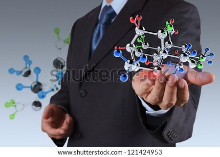 businessman holding a molecule - stock photo