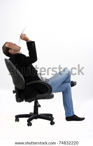 businessman holding a paper plane and siting on a chair. isolated on white - stock photo