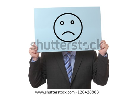 Businessman holding a paper with a negative smiley on white background - stock photo