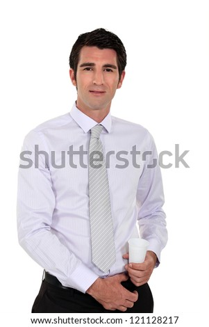 Businessman holding a plastic disposable cup - stock photo