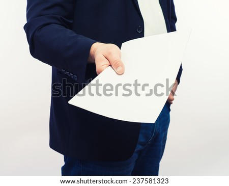 Businessman holding a poster - stock photo