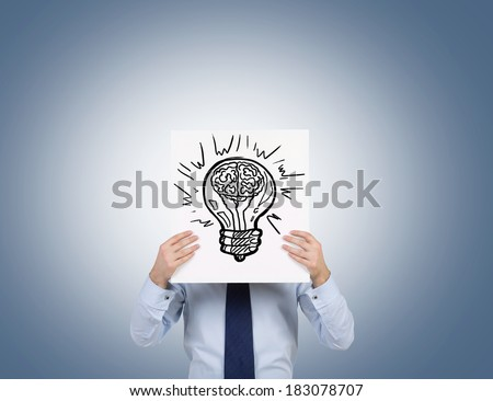 Businessman holding a poster with a lightbulb - stock photo