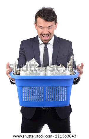 Businessman holding a shopping cart full of money isolated on white background - stock photo