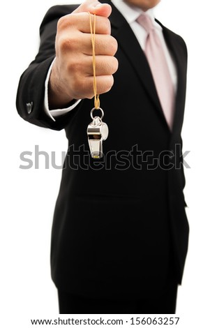 Businessman holding a silver whistle. - stock photo