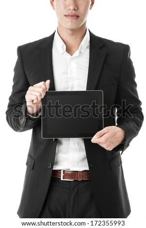 Businessman holding a tablet - stock photo