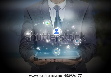 businessman holding a tablet PC with contact on virtual screens - business, technology, internet and social networking concept - stock photo
