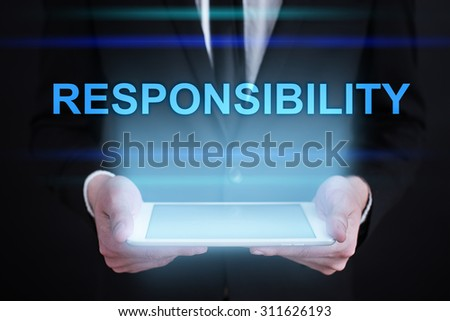 """Businessman holding a tablet pc with """"Responsibility"""" text on virtual screen. Internet concept. Business concept. - stock photo"""
