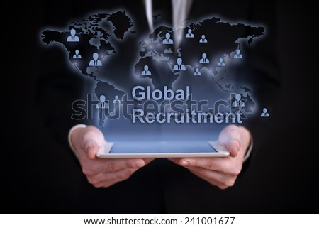 businessman holding a tablet PC with the projection map of the world on the screen. icons and people around the world. global recruitment. job search. International recruitment. business concept - stock photo