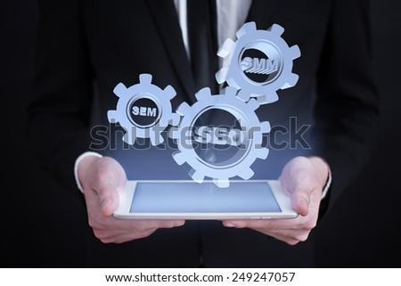 Businessman holding a tablet with internet marketing concept. online marketing. seo, sem, smm. - stock photo