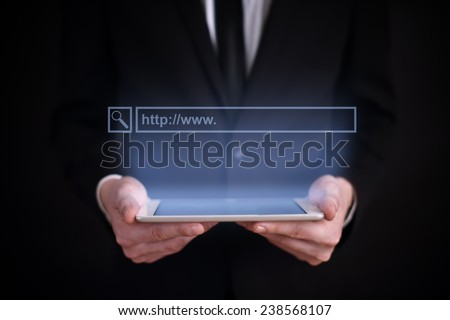 Businessman holding a tablet with the projection browser line above the screen. business concept. Internet concept. search. Web surfing. - stock photo