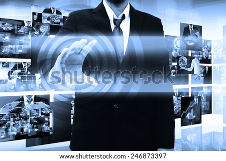 businessman holding a touch screen interface - stock photo