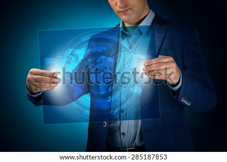 Businessman holding a transparent screen with an icon Social Network. Business, technology, internet and networking concept. - stock photo