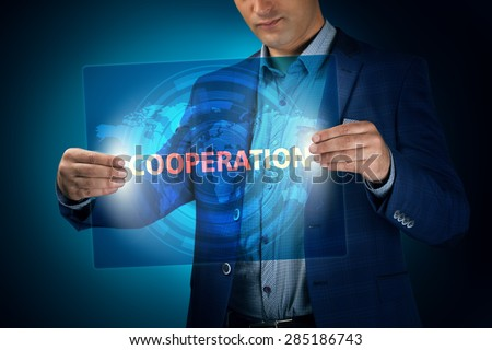 Businessman holding a transparent screen with an inscription a cooperaion. Business, technology, internet and networking concept. - stock photo