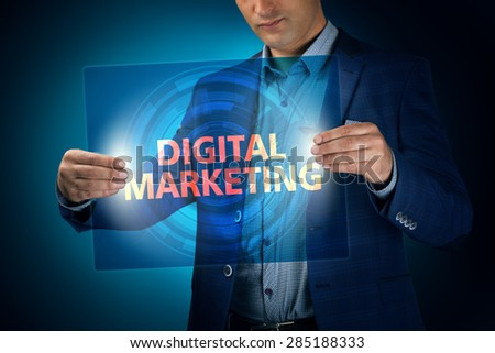 Businessman holding a transparent screen with an inscription a digital marketing. Business, technology, internet and networking concept. - stock photo