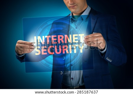 Businessman holding a transparent screen with an inscription a internet security. Business, technology, internet and networking concept. - stock photo