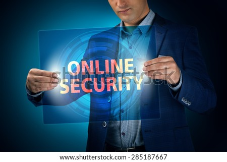Businessman holding a transparent screen with an inscription a online security. Business, technology, internet and networking concept. - stock photo