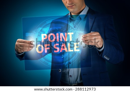 Businessman holding a transparent screen with an inscription a point of sale. Business, technology, internet and networking concept. - stock photo