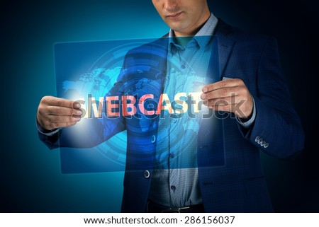 Businessman holding a transparent screen with an inscription a webcast. Business, technology, internet and networking concept. - stock photo