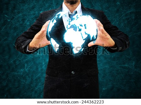 businessman  holding a world - stock photo
