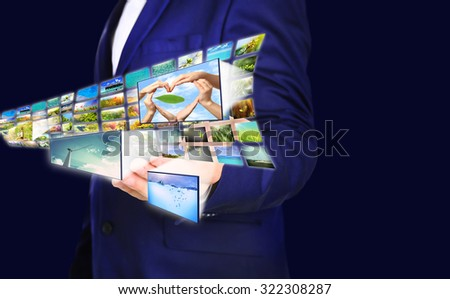 Businessman holding airplane of streaming images - stock photo