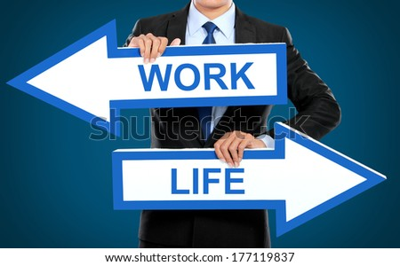 Businessman holding arrow in hand, work and life concept - stock photo