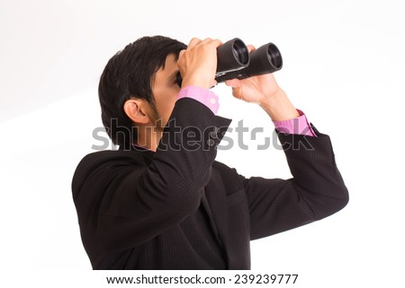 Businessman holding binoculars for search and check his business - stock photo
