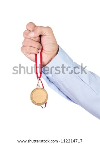 Businessman holding blank gold medal isolated over white background - stock photo