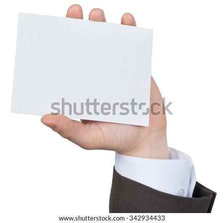 Businessman holding blank paper on isolated white background - stock photo