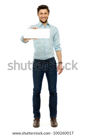 Businessman holding blank poster - stock photo