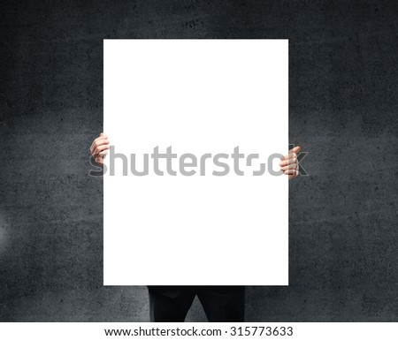 businessman holding blank poster in hand. - stock photo