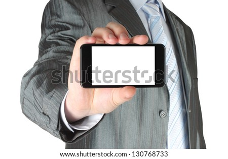 Businessman holding blank smart phone on white background - stock photo