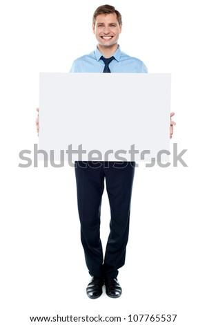 Businessman holding blank white billboard, full length portrait - stock photo