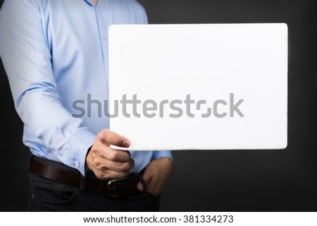 Businessman holding blank white board for copy space - stock photo
