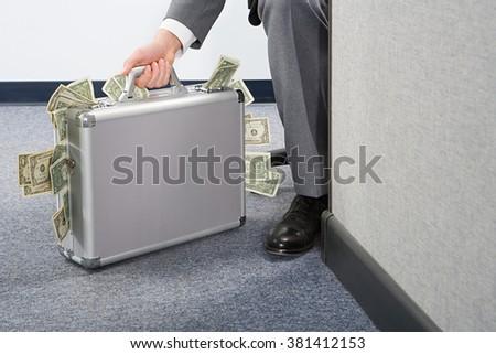Businessman holding briefcase - stock photo