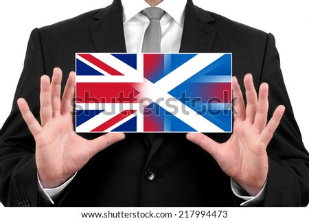 Businessman holding business card with Scotland and United Kingdom Flag - stock photo