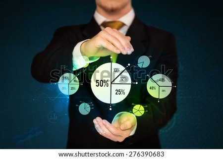 Businessman holding business diagrams, concept of success - stock photo