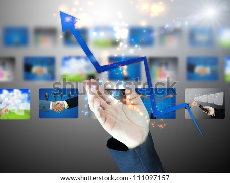 Businessman holding business graph - stock photo
