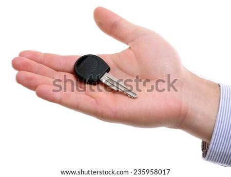 Businessman holding car key isolated on white - stock photo
