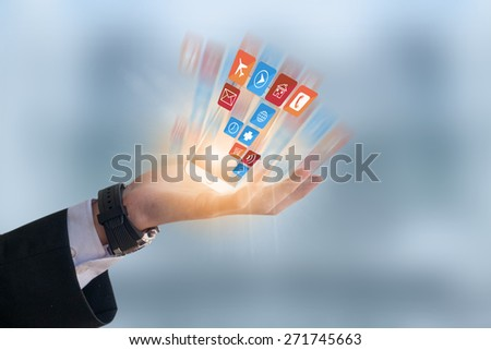 Businessman holding cell phone - stock photo