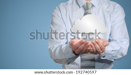 Businessman holding cloud computer network technology in hands - stock photo