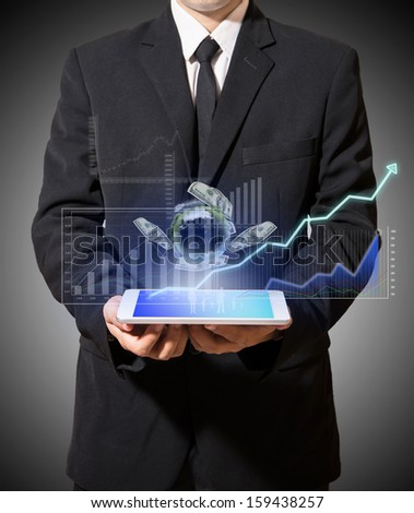 businessman holding digital graph improve suggest more on tablet - stock photo