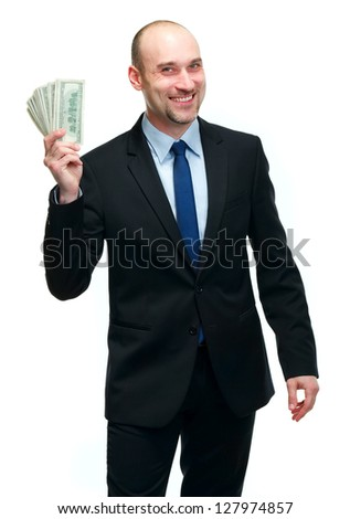 Businessman holding dollar bills - stock photo