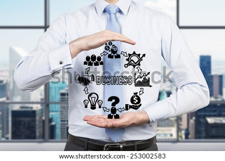 businessman holding drawing business icons, close up - stock photo