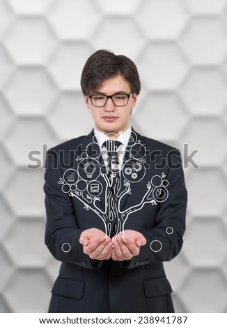 businessman holding drawing business tree - stock photo